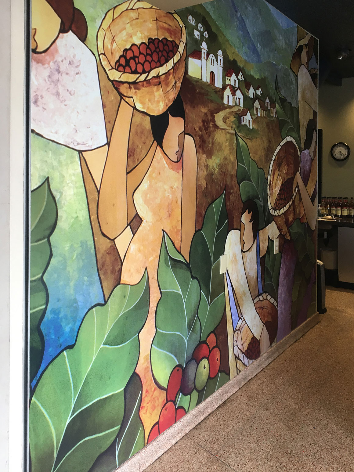 Colorful artist rendition mural in a coffee house cafe depicting coffee being harvested in the fields of Honduras