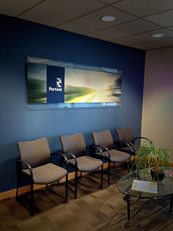 Wall sign for lobby at Perteet Engineering. Installed with architectural standoffs. MAINMEDIA.